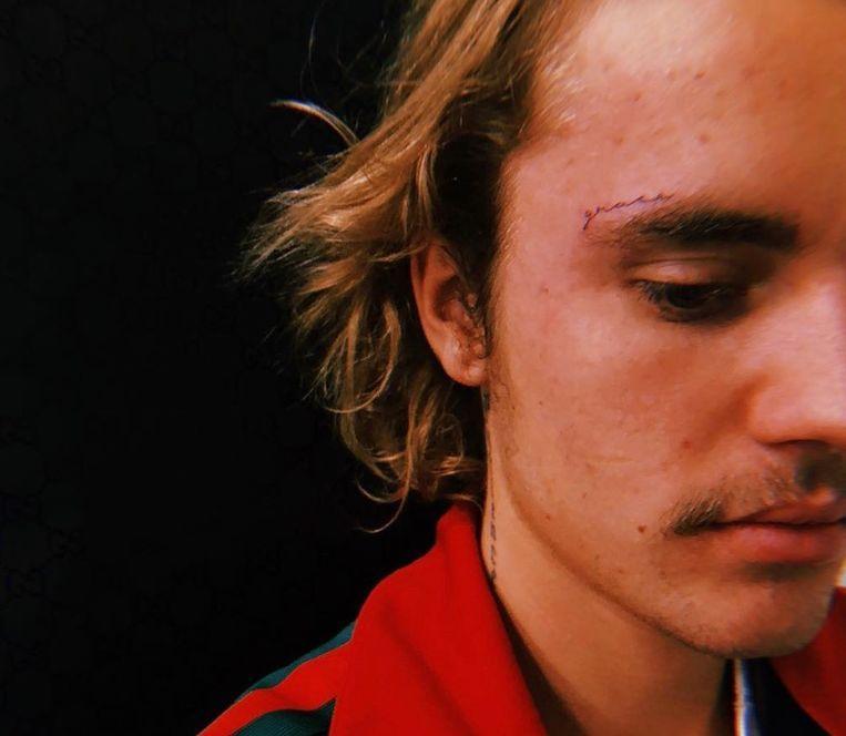 Justin Bieber Reveals Facial Tattoo Afrinik