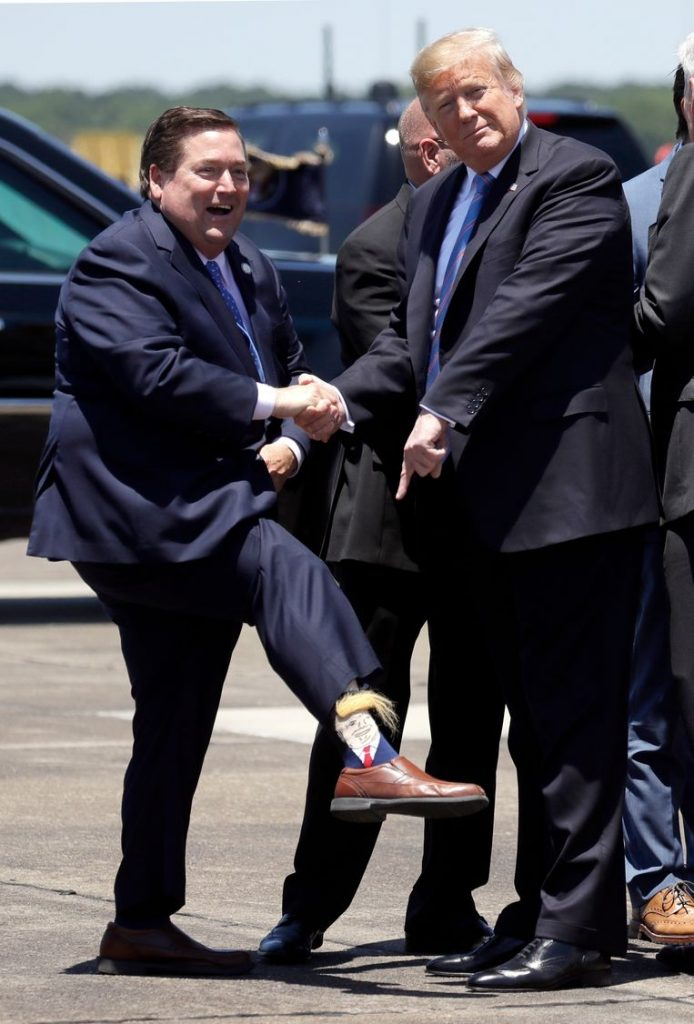 Deputy Governor greets American President with bizarre (hairy) Trump socks
