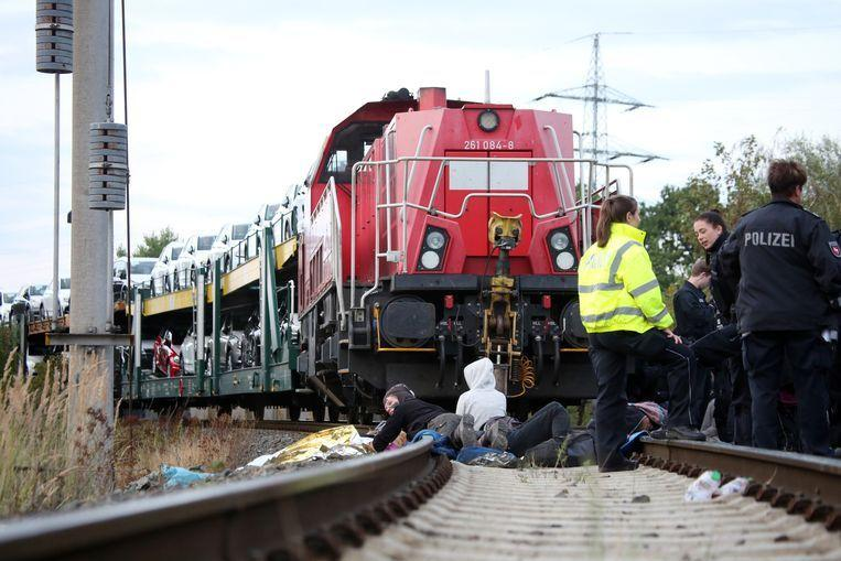 Climate protest ended where activists blocked train with VW cars