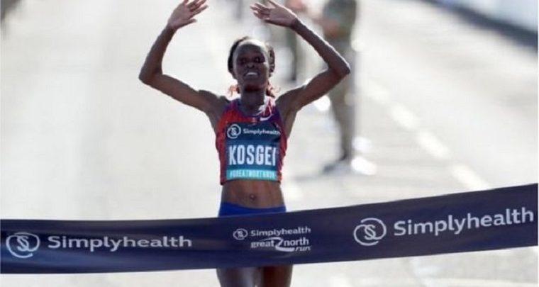 Photo of Kenyan Kosgei holds world record for women's half marathon
