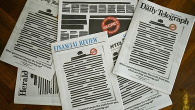 Front pages of Australian newspapers are blacked out in protest