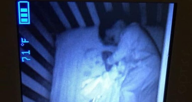 Photo of Mother sees 'ghost' next to sleeping baby