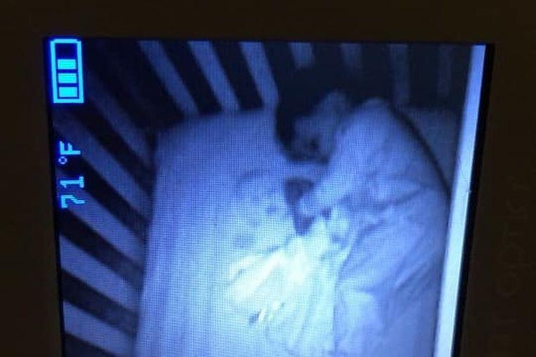 Mother sees 'ghost' next to sleeping baby
