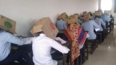 Students put carton box on the head during the exam